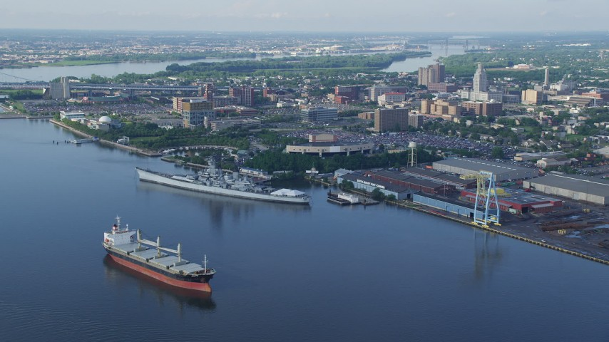 5K stock footage aerial video approaching USS New Jersey on Delaware River, BB&T Pavilion, and Balzano Marine Terminal, Camden, New Jersey Aerial Stock Footage | AX79_088