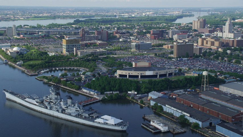 5K stock footage aerial video tilting down on USS New Jersey by BB&T Pavilion in Camden, New Jersey Aerial Stock Footage AX79_089 | Axiom Images