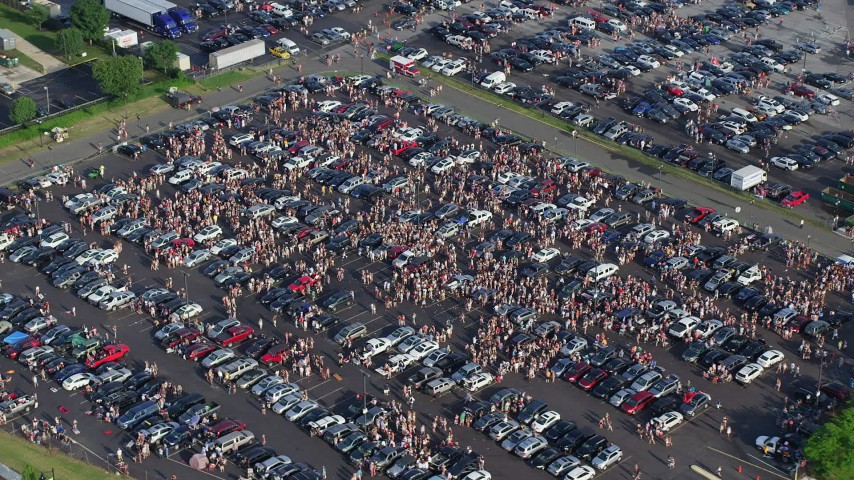5K stock footage aerial video of crowds tailgaiting  in a parking lot, Campbell's Field, Camden, New Jersey Aerial Stock Footage | AX79_091