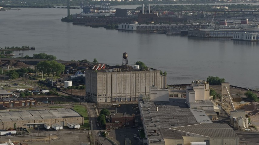 5K stock footage aerial video of a factory building beside the Delaware River, Camden, New Jersey Aerial Stock Footage | AX79_095