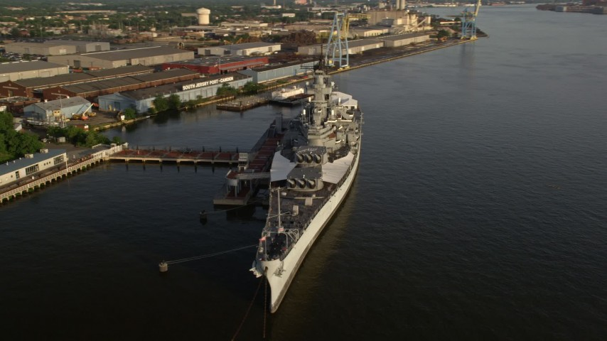 5K stock footage aerial video of the USS New Jersey on the Delaware River, Camden, New Jersey, Sunset Aerial Stock Footage | AX80_001