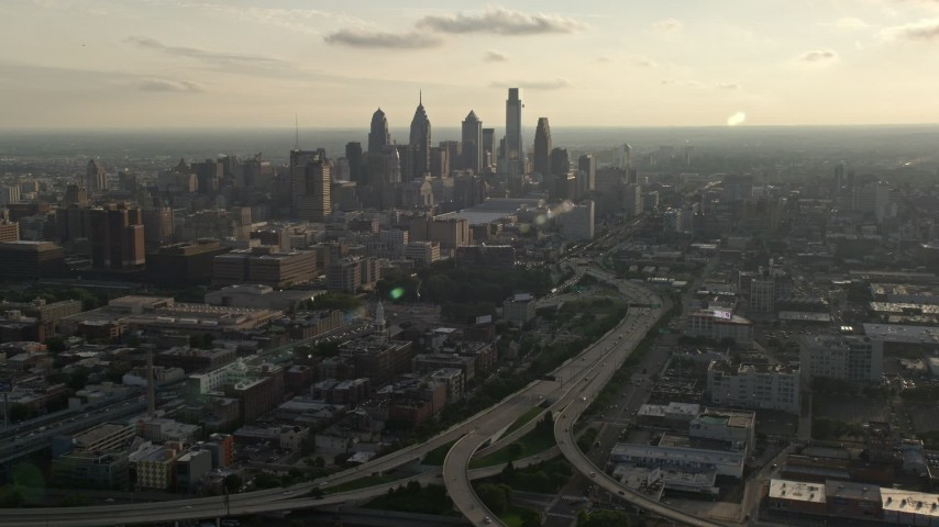 5K stock footage aerial video of I-676 to Downtown Philadelphia skyline, Pennsylvania, Sunset Aerial Stock Footage | AX80_004
