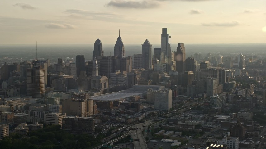 5K stock footage aerial video of the Downtown Philadelphia skyline and Pennsylvania Convention Center, Pennsylvania, Sunset Aerial Stock Footage | AX80_005
