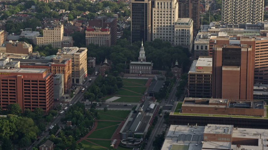 5K stock footage aerial video of Independence Hall seen across Independence Mall in Downtown Philadelphia, Pennsylvania, Sunset Aerial Stock Footage | AX80_006