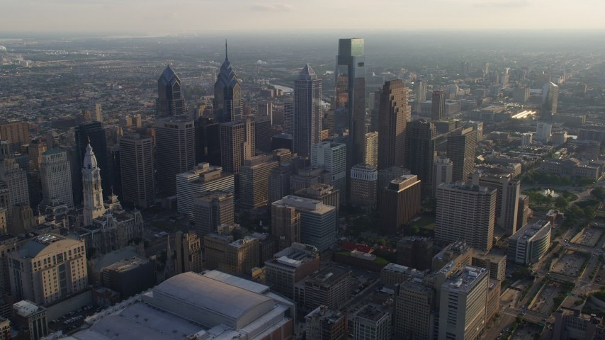 5K aerial video approaching Downtown Philadelphia's City Hall and tall skyscrapers, Pennsylvania, Sunset Aerial Stock Footage | AX80_007