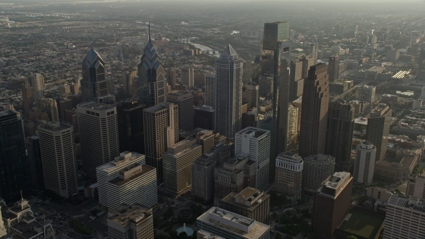 5K stock footage aerial video approaching Downtown Philadelphia's City Hall and tall skyscrapers, Pennsylvania, Sunset Aerial Stock Footage | AX80_007E