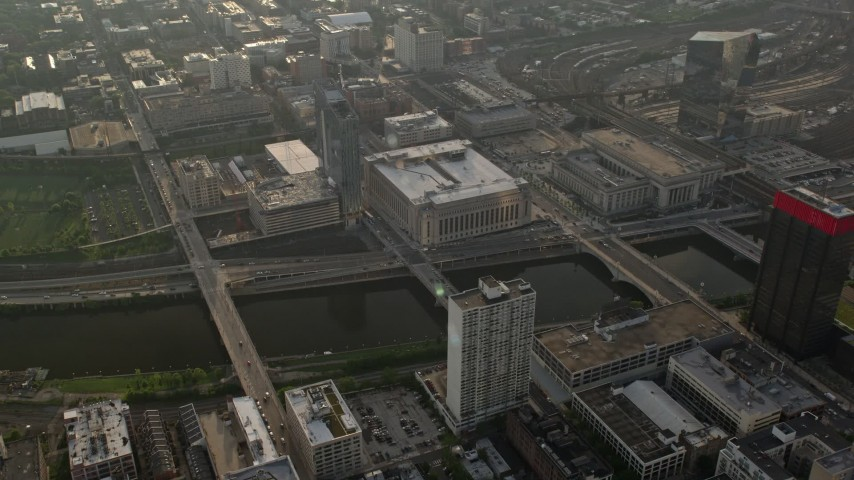 5K stock footage aerial video of small bridges over Schuylkill River, Main Post Office, 30th Street Station, Philadelphia, Pennsylvania, Sunset Aerial Stock Footage | AX80_010