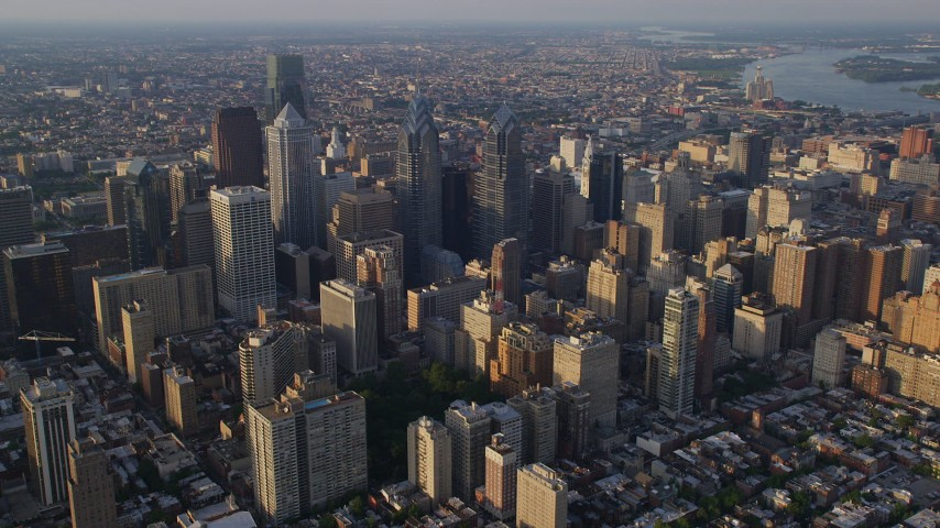5K stock footage aerial video of Downtown Philadelphia skyscrapers and city buildings in Pennsylvania, Sunset Aerial Stock Footage | AX80_011