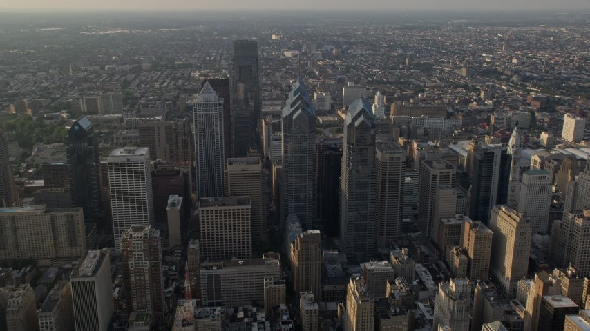 5K stock footage aerial video of Downtown Philadelphia skyscrapers, city buildings and urban neighborhoods in Pennsylvania, Sunset Aerial Stock Footage   AX80_011E