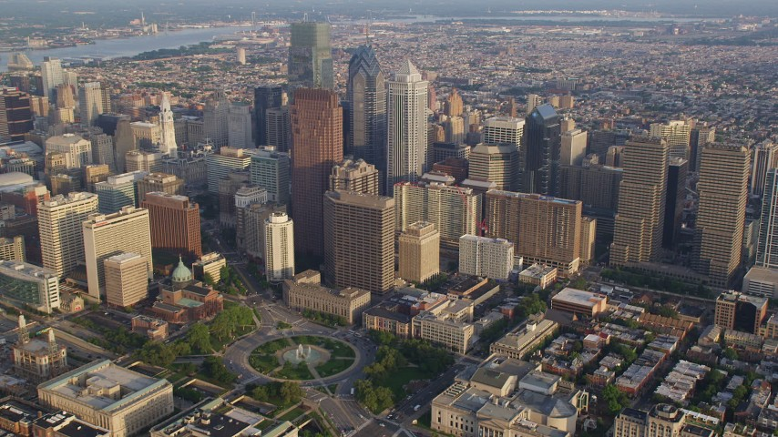 5K stock footage aerial video approaching City Hall and skyscrapers in Downtown Philadelphia, Pennsylvania, Sunset Aerial Stock Footage | AX80_016