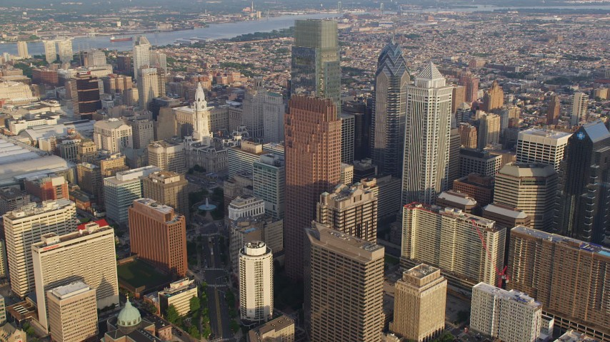 5K aerial video approaching City Hall and Comcast Center in Downtown Philadelphia, Pennsylvania, Sunset Aerial Stock Footage | AX80_017