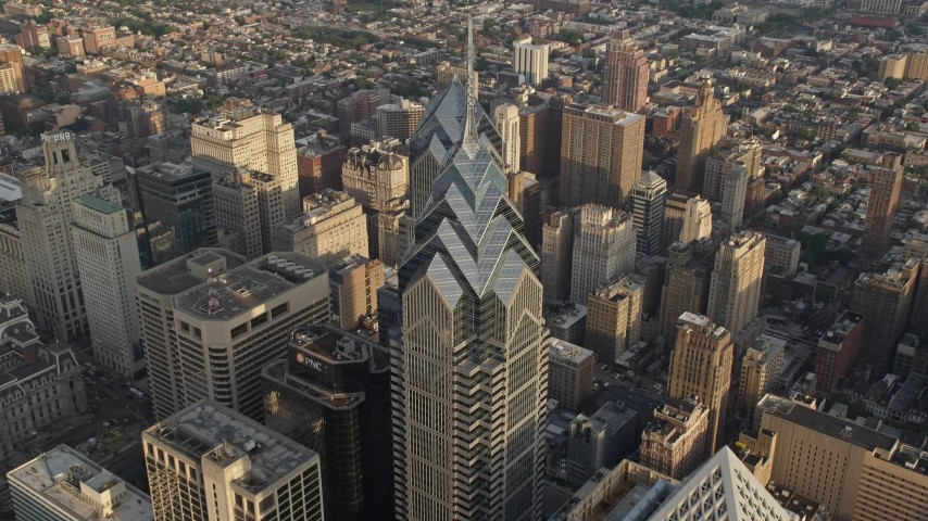 5K stock footage aerial video tilting to bird's eye of One and Two Liberty Place in Downtown Philadelphia, Pennsylvania, Sunset Aerial Stock Footage | AX80_018