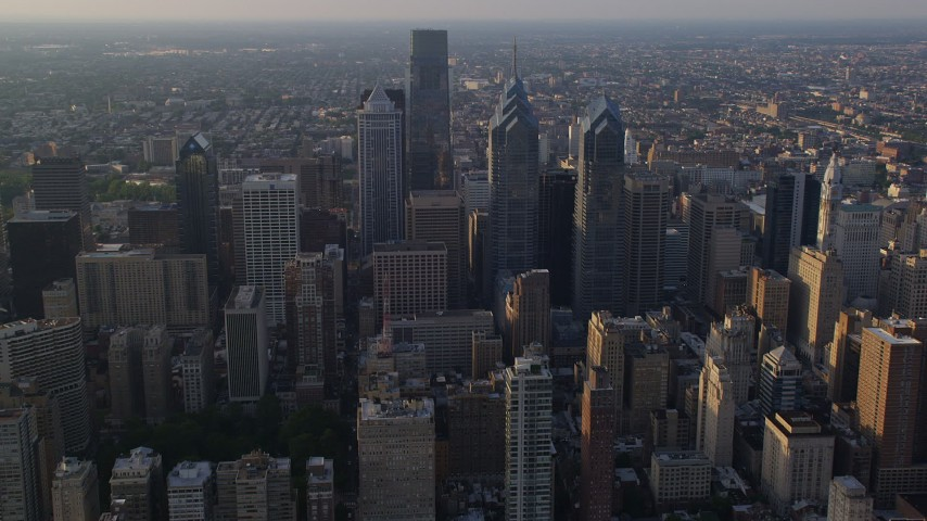 5K stock footage aerial video approaching Downtown Philadelphia's tallest skyscrapers, Pennsylvania, Sunset Aerial Stock Footage | AX80_022