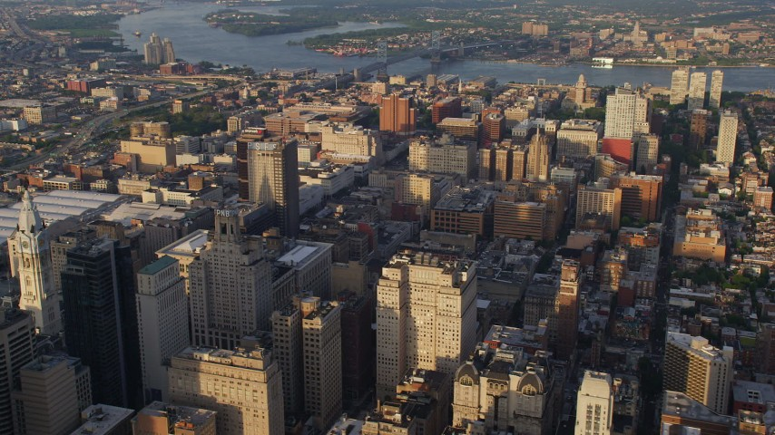 5K aerial video flying by office and apartment buildings, reveal City Hall, Downtown Philadelphia, Pennsylvania, Sunset Aerial Stock Footage | AX80_023