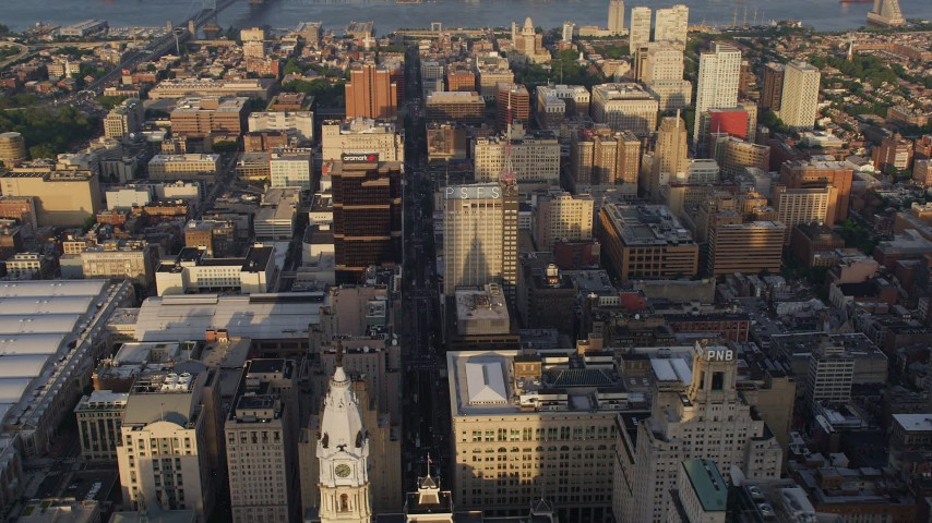 5K stock footage aerial video of office buildings in Downtown Philadelphia, Pennsylvania, Sunset Aerial Stock Footage | AX80_024