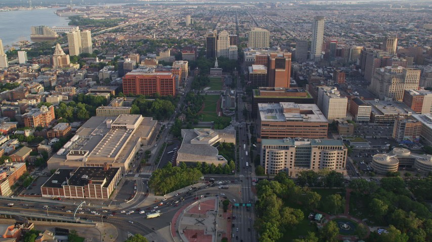 5K stock footage aerial video flying over National Constitution Center and Mall to approach Independence Hall, Philadelphia, Pennsylvania, Sunset Aerial Stock Footage | AX80_026
