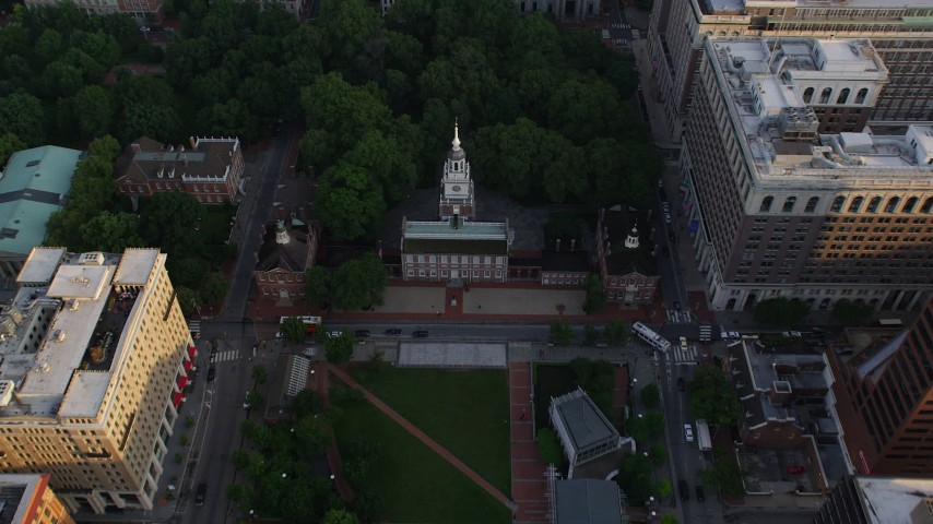 5K stock footage aerial video approaching Independence Hall and tilt to a bird's eye view, Philadelphia, Pennsylvania, Sunset Aerial Stock Footage AX80_027 | Axiom Images