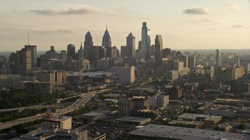 5K stock footage aerial video of Downtown Philadelphia skyline and Pennsylvania Convention Center at Sunset Aerial Stock Footage | AX80_031