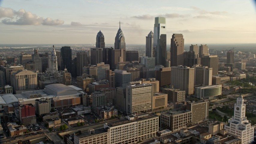 5K aerial video approaching Downtown Philadelphia skyscrapers and high-rises in Pennsylvania, Sunset Aerial Stock Footage | AX80_033