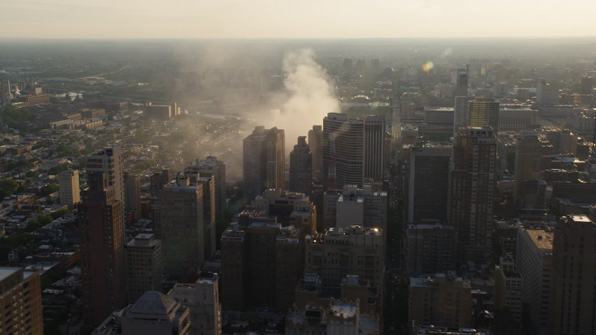 5K aerial video of residential fire near office buildings in Downtown Philadelphia, Pennsylvania, Sunset Aerial Stock Footage | AX80_035
