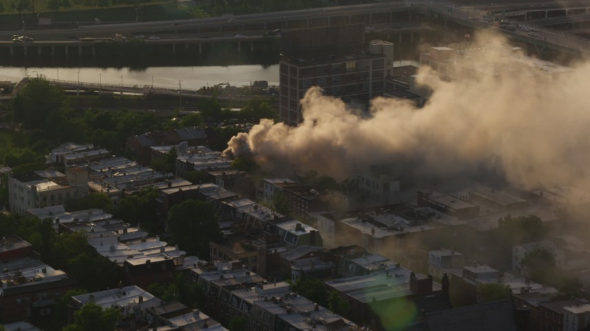5K stock footage aerial video of thick smoke from a residential fire near Downtown Philadelphia, Pennsylvania, Sunset Aerial Stock Footage | AX80_037