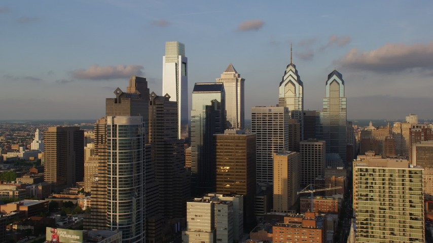 Flyby Downtown Philadelphia skyscrapers, Pennsylvania, Sunset Aerial Stock Footage | AX80_044