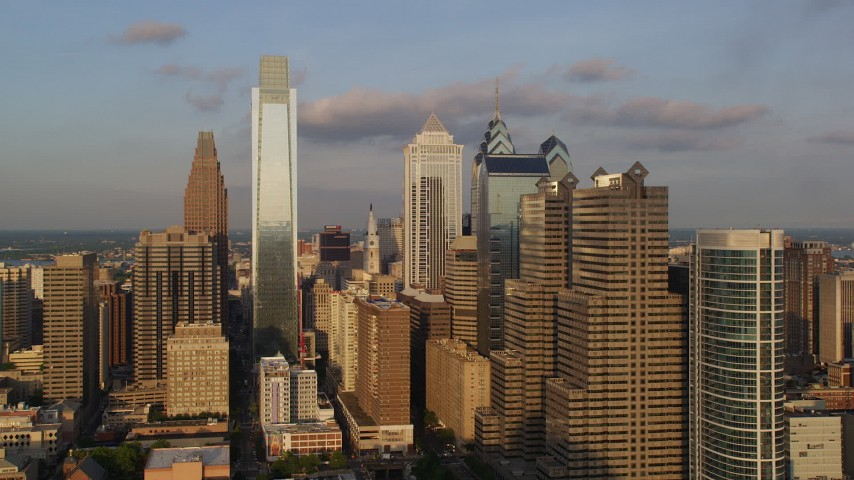 5K aerial video of Downtown Philadelphia high-rises and skyscrapers in Pennsylvania at sunset Aerial Stock Footage | AX80_045