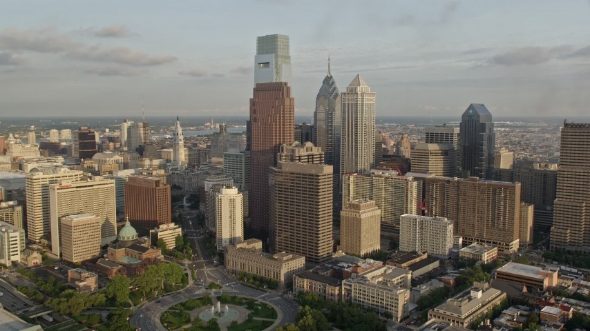 5K aerial video of Comcast Center, BNY Mellon Center, and Three Logan Square in Downtown Philadelphia, Pennsylvania, Sunset Aerial Stock Footage | AX80_046