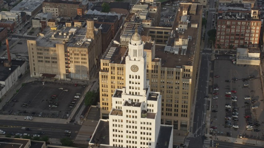 Inquirer Building clock tower in Downtown Philadelphia, Pennsylvania, Sunset Aerial Stock Footage | AX80_047