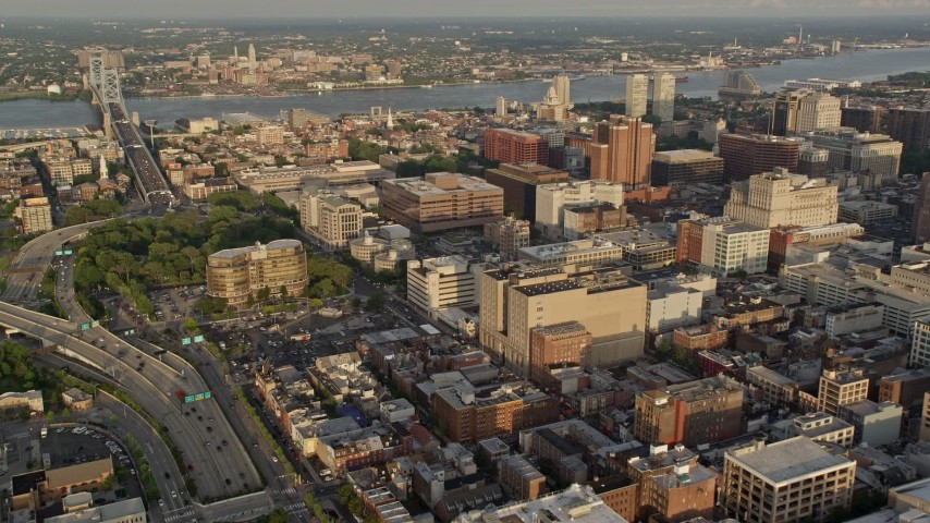 5K stock footage aerial video flying by office buildings in Downtown Philadelphia, Pennsylvania, Sunset Aerial Stock Footage | AX80_048