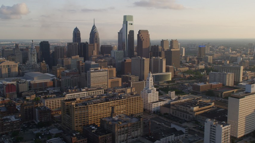 5K stock footage aerial video of Downtown Philadelphia's high-rises and skyscrapers, Pennsylvania, Sunset Aerial Stock Footage | AX80_049