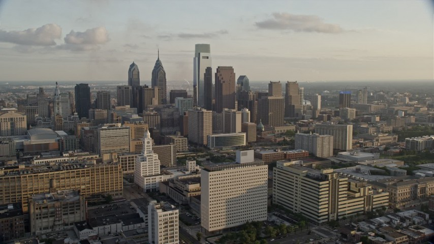 5K stock footage aerial video of Downtown Philadelphia's high-rises and skyscrapers, Pennsylvania, Sunset Aerial Stock Footage   AX80_049E