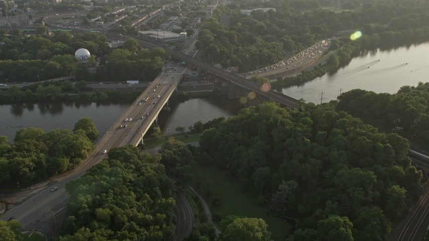 5K stock footage aerial video approaching Girard Bridge spanning the Schuylkill River in Philadelphia, Pennsylvania, Sunset Aerial Stock Footage | AX80_053