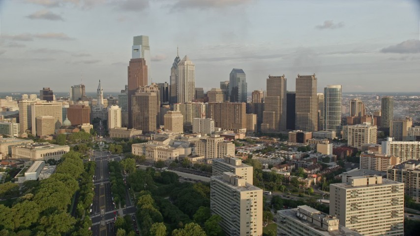 5K stock footage aerial video approaching Philadelphia City Hall and skyscrapers in Downtown Philadelphia, Pennsylvania, Sunset Aerial Stock Footage | AX80_056