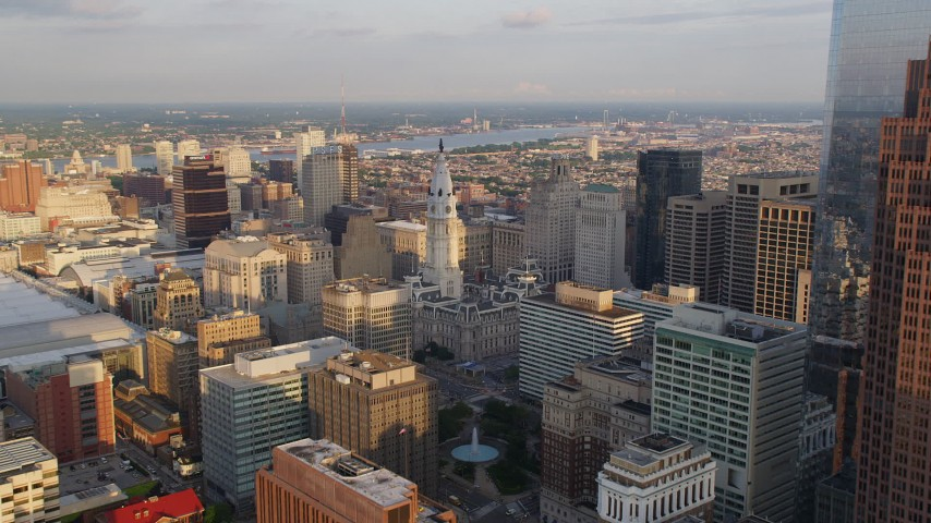 5K stock footage aerial video approaching the William Penn statue atop City Hall in Downtown Philadelphia, Pennsylvania, Sunset Aerial Stock Footage | AX80_057