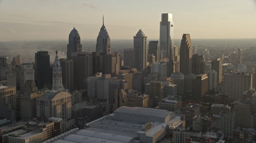 5K stock footage aerial video of skyscrapers in Downtown Philadelphia, Pennsylvania at sunset Aerial Stock Footage | AX80_060