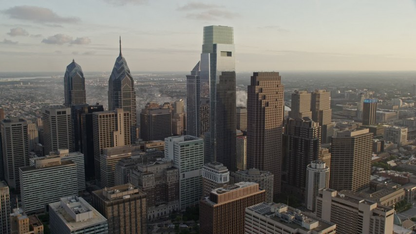 5K stock footage aerial video flying by Downtown Philadelphia skyscrapers, Pennsylvania, Sunset Aerial Stock Footage | AX80_061