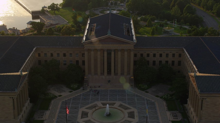 5K stock footage aerial video flying over The Oval and Washington Monument Fountain to approach Philadelphia Museum of Art, Pennsylvania, Sunset Aerial Stock Footage | AX80_063
