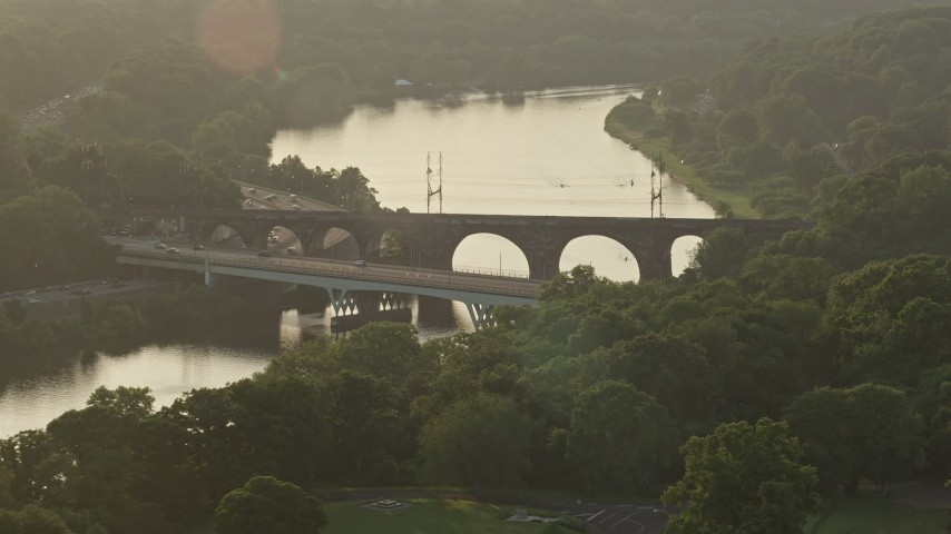 5K aerial video of Girard Bridge spanning the Schuylkill River, Philadelphia, Pennsylvania, Sunset Aerial Stock Footage | AX80_064