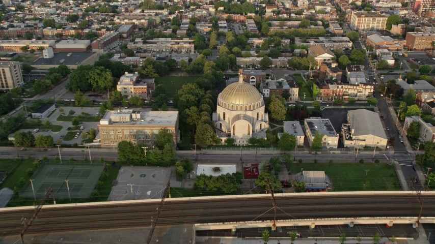 5K stock footage aerial video approaching and tilting to Ukrainian Cathedral Church, North Philadelphia, Pennsylvania Sunset Aerial Stock Footage | AX80_071