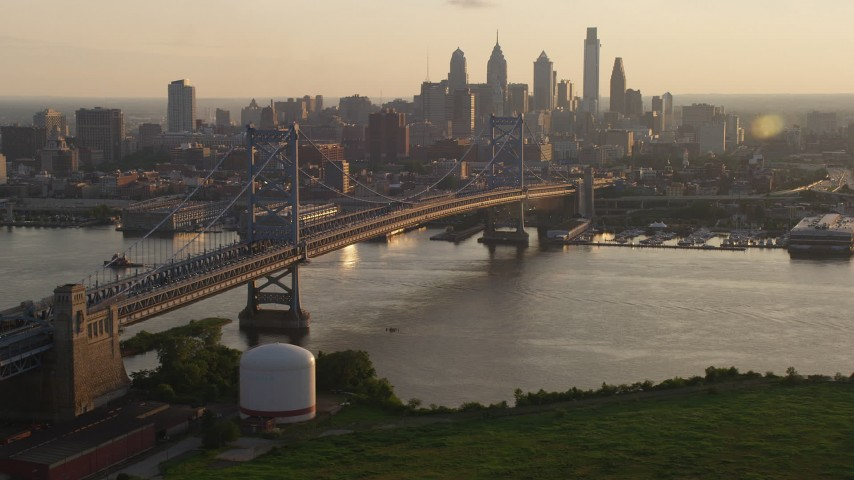 5K stock footage aerial video of Benjamin Franklin Bridge and Downtown Philadelphia skyline, Pennsylvania, Sunset Aerial Stock Footage AX80_075