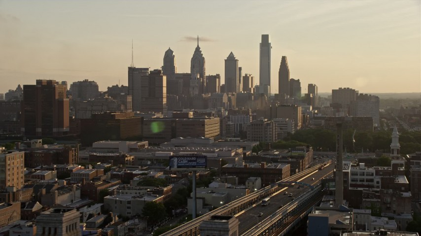 5K aerial video approaching the Downtown Philadelphia skyline in Pennsylvania, Sunset Aerial Stock Footage | AX80_077