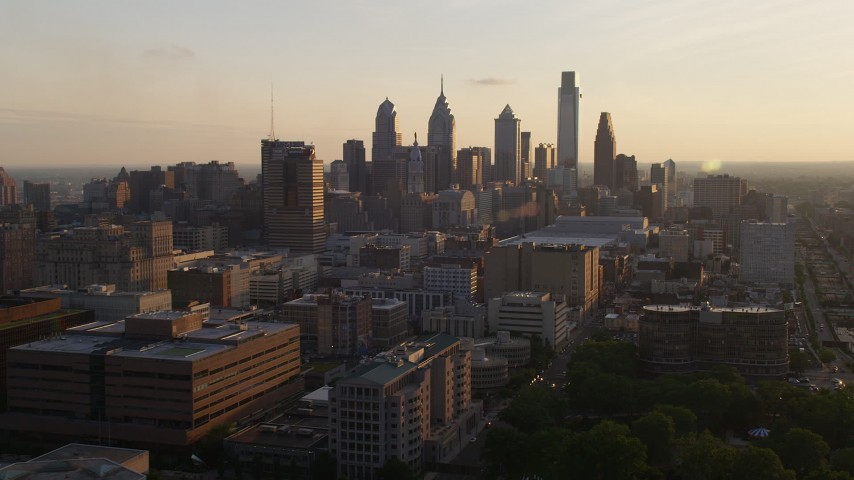 5K stock footage aerial video approaching the Downtown Philadelphia skyline and convention center in Pennsylvania, Sunset Aerial Stock Footage | AX80_078