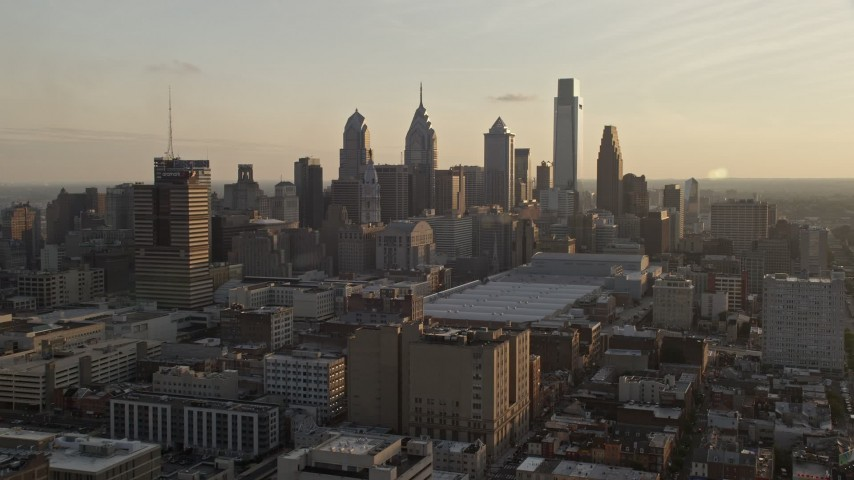 5K stock footage aerial video approaching the Downtown Philadelphia skyline and convention center in Pennsylvania, Sunset Aerial Stock Footage | AX80_078E