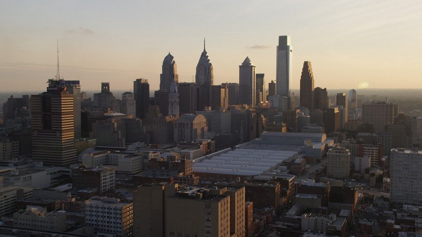 5K aerial video of Downtown Philadelphia skyscrapers and convention center, Pennsylvania, Sunset Aerial Stock Footage | AX80_079