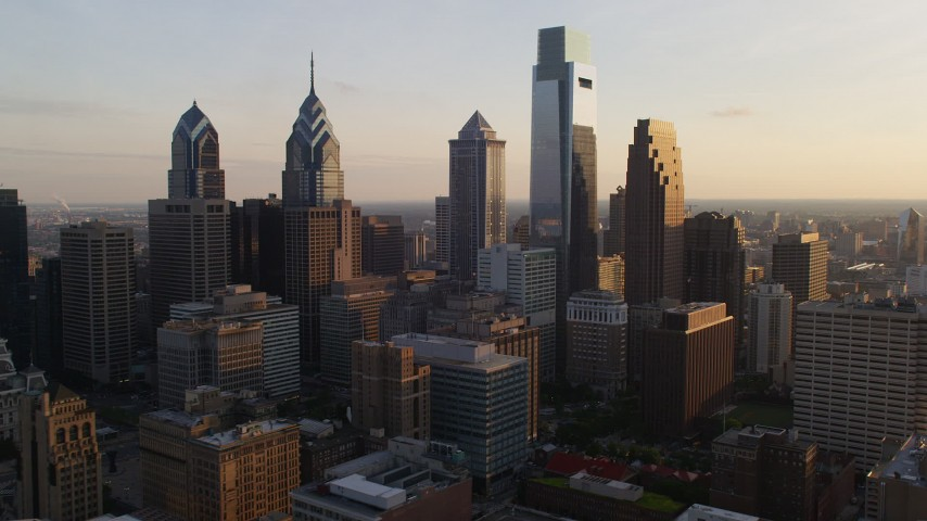 5K stock footage aerial video flying by Downtown Philadelphia's tall skyscrapers, Pennsylvania, Sunset Aerial Stock Footage | AX80_081