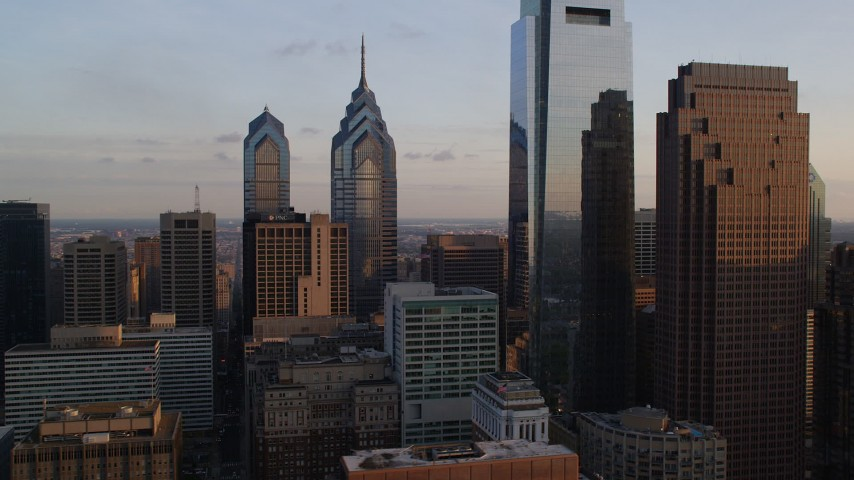 5K aerial video of One and Two Liberty Place, Comcast Center, and Three Logan Square in Downtown Philadelphia, Pennsylvania, Sunsest Aerial Stock Footage | AX80_082