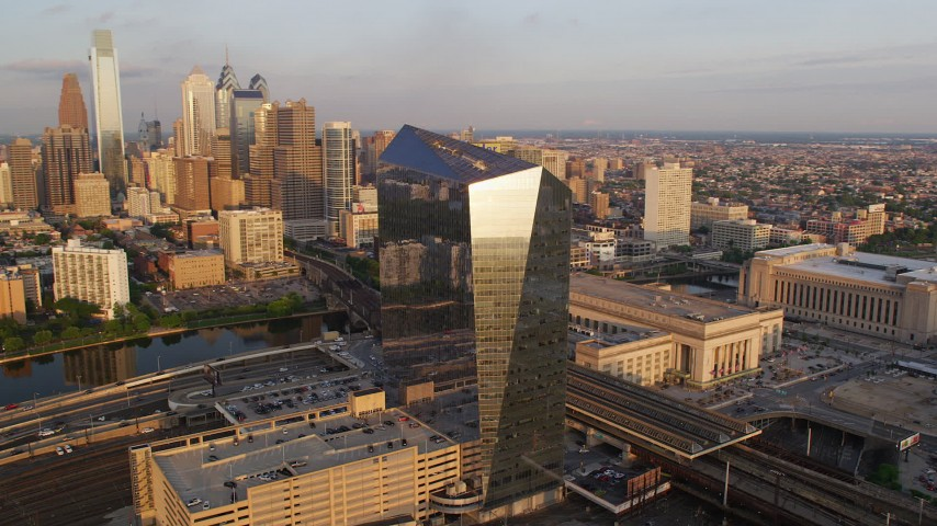 Orbit Cira Centre and reveal the Downtown Philadelphia skyline, Pennsylvania, Sunset Aerial Stock Footage | AX80_085