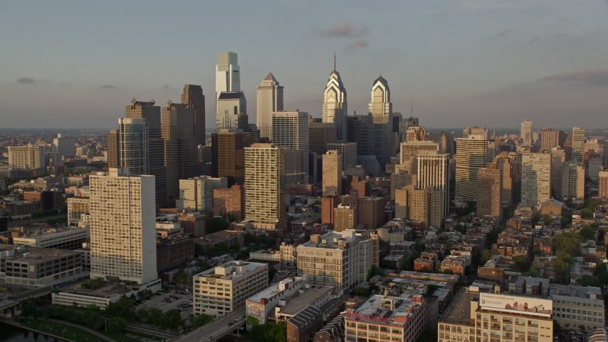 5K stock footage aerial video of skyscrapers and high-rises in Downtown Philadelphia, Pennsylvania, Sunset Aerial Stock Footage | AX80_087