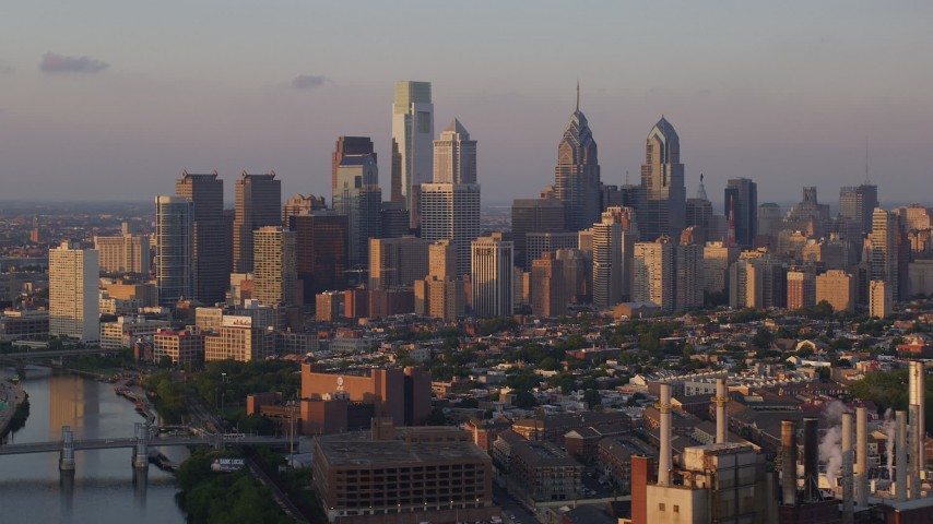 5K aerial video of Downtown Philadelphia skyline seen from Schuylkill River, Pennsylvania, Sunset Aerial Stock Footage | AX80_090